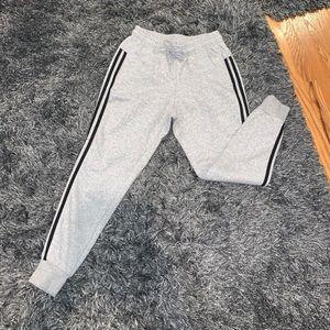 Gray adidas joggers.